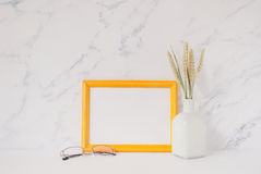 Yellow wooden photo frame mockup, bouquet of wheat spikelets Stock Photos