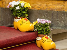 Yellow wooden. Shoes as a decor element Royalty Free Stock Photography