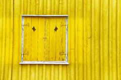 Yellow wooden shutters Stock Images