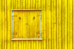 Yellow wooden shutters Stock Photos