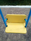 Yellow wooden swing Royalty Free Stock Images