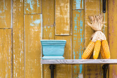 Yellow wooden wall with decoration Royalty Free Stock Photo
