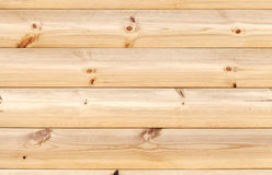 Yellow wooden wall made of pine tree boards Royalty Free Stock Images