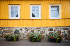 Yellow wooden wall with some windows Royalty Free Stock Images