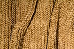 Yellow wool knitted scarf closeup. royalty free stock image