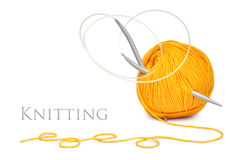 Yellow wool and knitting needles Royalty Free Stock Photos