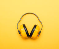 Yellow working protective headphones Stock Images