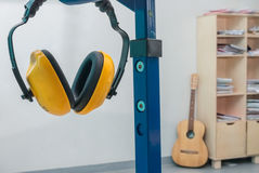 Yellow working protective headphones Royalty Free Stock Images