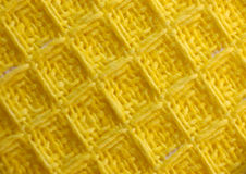 Yellow Woven Fabric. Close-up of woven fabric textile with a square basket weave pattern Stock Image