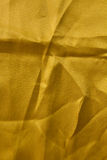Yellow wrinkled fabric surface. Royalty Free Stock Image