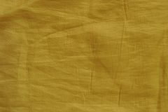 Yellow wrinkled fabric texture for background Stock Image