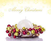 Yellow xmas background, card. White candle in candle holder with text Royalty Free Stock Photo