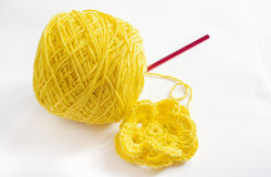Yellow yarn and a crochet flower Royalty Free Stock Photo