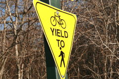 Yellow Yield Sign In Park Stock Photo