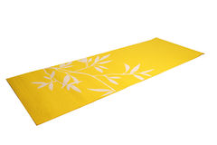Yellow yoga mat on a white background Stock Image