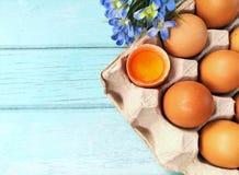 Yellow yolk, beautiful decoration, wooden background, egg on table Stock Image