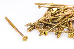 Yellow zinc coated screws on a white background Stock Image