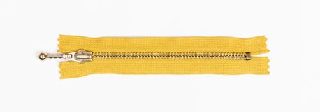 Yellow zipper isolated on white. top view Royalty Free Stock Photography