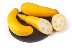 Yellow zucchini squash on the shale board, isolated on white background. stock image