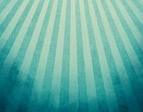 Yellowed blue retro background with faded grunge borders and soft blue and yellow stripes sunburst effect or starburst design Stock Images