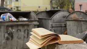 Yellowed Book and Dumpster stock video footage