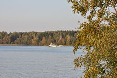 Yellowed lake against a lake with a yacht royalty free stock photography