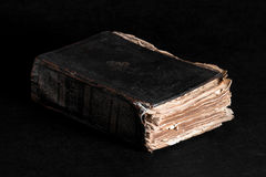 Yellowed old thick book on the table Stock Photography