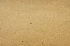 Yellowed paper. Old, yellowed piece of paper as a background or texture Stock Images