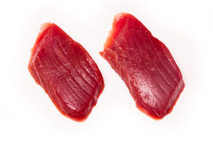Yellowfin tuna fish steaks isolated on a white background Royalty Free Stock Photos