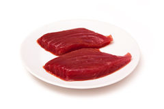 Yellowfin tuna fish steaks isolated on a white background Royalty Free Stock Photo