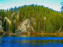 Yellowhead Trail Mount Robson Provincial Park, British Columbia. Lake with trees and rocks Stock Image
