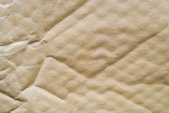 Yellowish bubblewrap paper parcel surface useful as a background Stock Photos