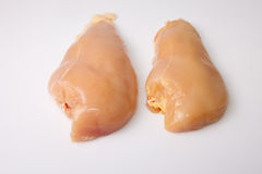 Yellowish chicken breasts Royalty Free Stock Image