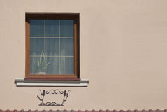 Yellowish wall with window Royalty Free Stock Photography