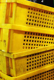Yellowl plastic - stacked packing containers. Stock Photos