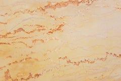 Yelloworange marmortextur, detaljerad struktur av marmor i naturligt mönstrat arkivbild