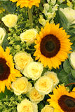 Yellows. Arrangement in yellow, of sunflowers, roses, antirrhinums and ladies mantle stock photography