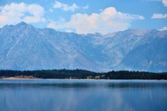 Yellowstone Lake. Sunny day looking across lake to mountains stock photography