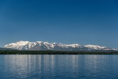 Yellowstone Lake with mountains landscape. Wyoming, USA stock images