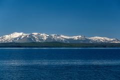 Yellowstone Lake with mountains landscape. Wyoming, USA royalty free stock photography