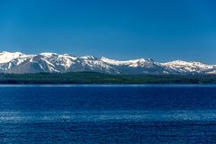 Yellowstone Lake with mountains landscape. Wyoming, USA stock image