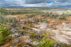 Yellowstone landscape of geyser pools and mud pots stock photos