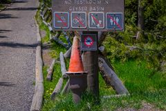 YELLOWSTONE, MONTANA, USA JUNE 02, 2018: Outdoor view of informative sign of not allow, smoking, pets, drones, bikes and. Restrooms in Norris Geyser Basin stock photos