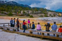 YELLOWSTONE, MONTANA, USA MAY 24, 2018: Unidentified people walking in a boardwalk in Mammoth Hot Springs,Yellowstone Stock Photography