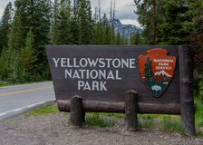 Yellowstone National Park Entrance Sign with mountains in distance. June 17, 2018: Yellowstone, United States: Yellowstone National Park Entrance Sign with stock images