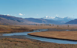 Yellowstone National Park: Gardner River. With snowcapped mountains Royalty Free Stock Photo