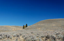 Yellowstone National Park: Hills close to Gardner. River with blue skies Royalty Free Stock Image