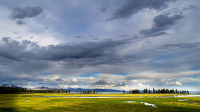Yellowstone National Park: Lake Area. Eye catching photograph of the meadow in front of the Yellowstone Lake Lodge during the Golden Hour with a dramatic sky stock images