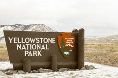 Yellowstone National Park sign at entrance in Wyoming in winter Stock Images