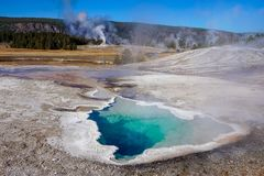 Yellowstone National Park thermal feature, bright blue stock photo